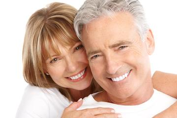 bright white teeth smiling couple