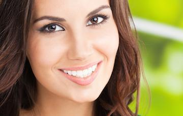 woman with Invisalign in chagrin falls