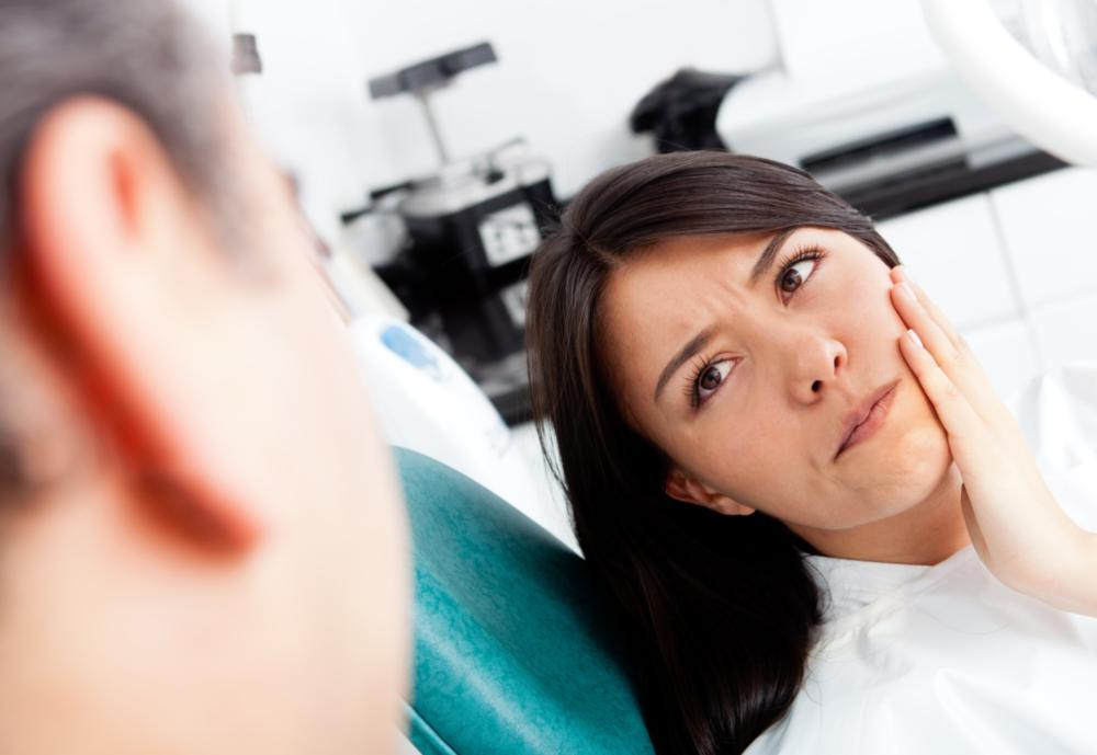 Image of patient with mouth pain | root canals | Chagrin Family Dental Care in Chagrin Falls, OH