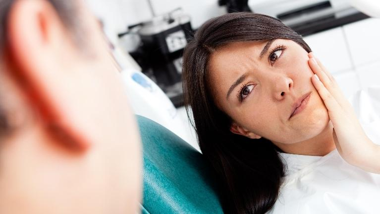 women with mouth pain | root canal chagrin falls oh